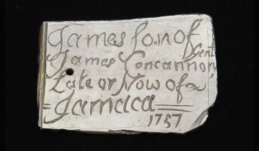 a photo of a fragment of porcelain with writing imprinted onto it