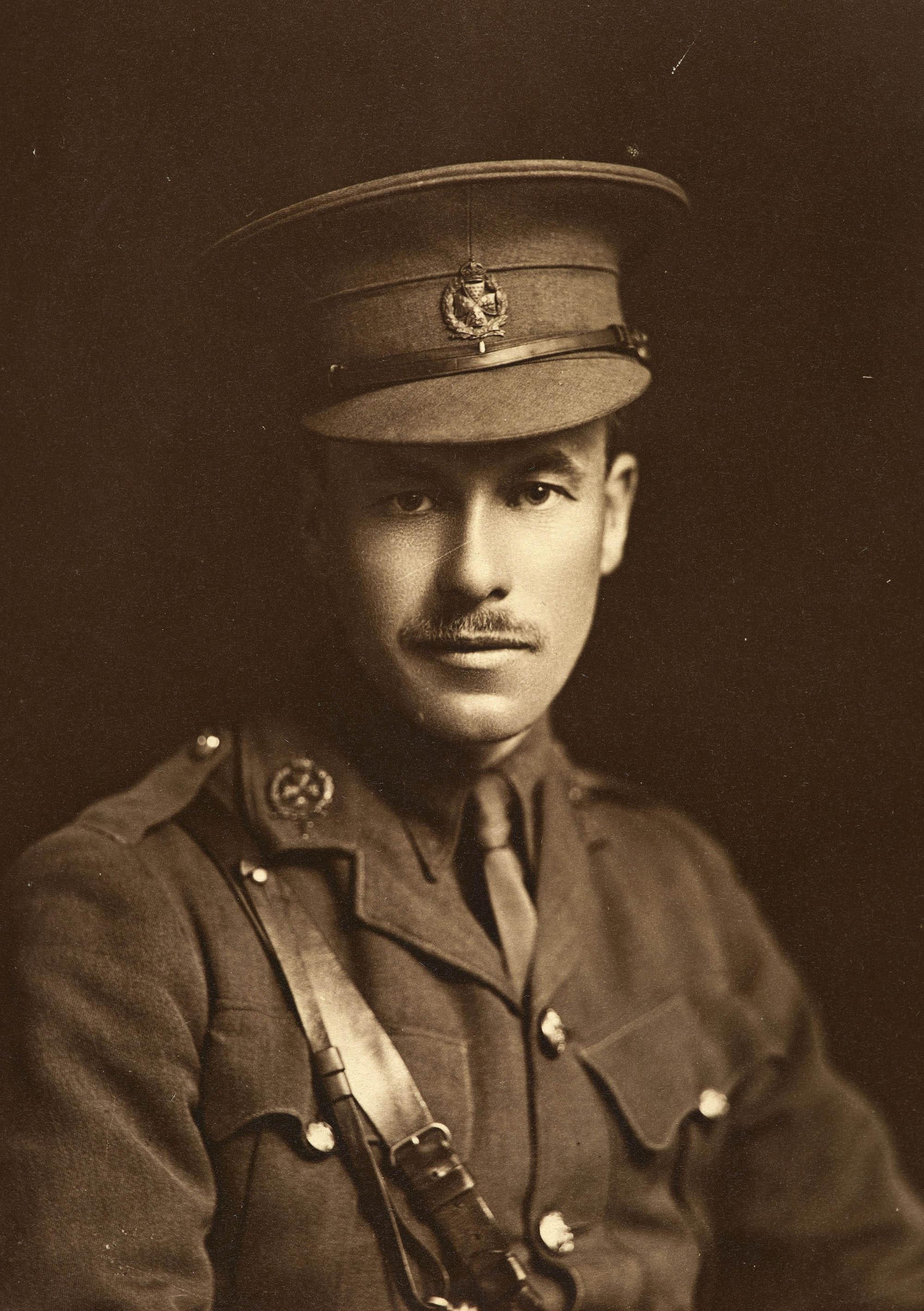 a studio photograph of a man in First World War officer's uniform