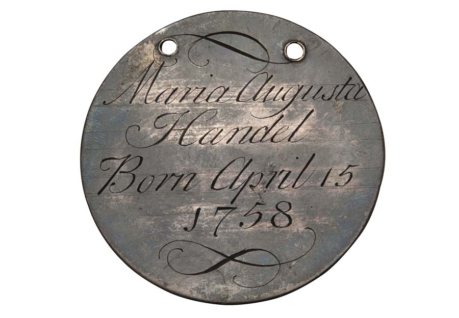 a round metal token with engraving on it