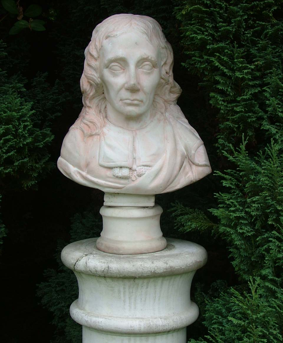 a photo of a bust of man with long hair