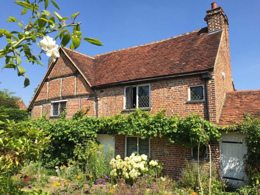 a photo of a brick built cottage