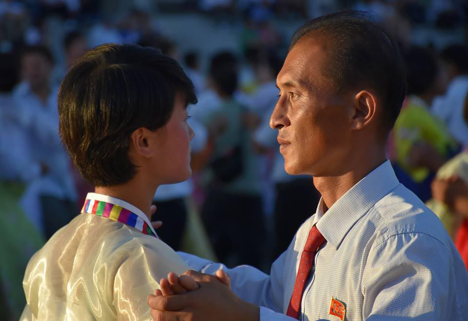 a photo of a Korean man and woman dancing