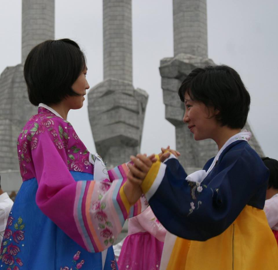 a photo of two North Korean women dancing