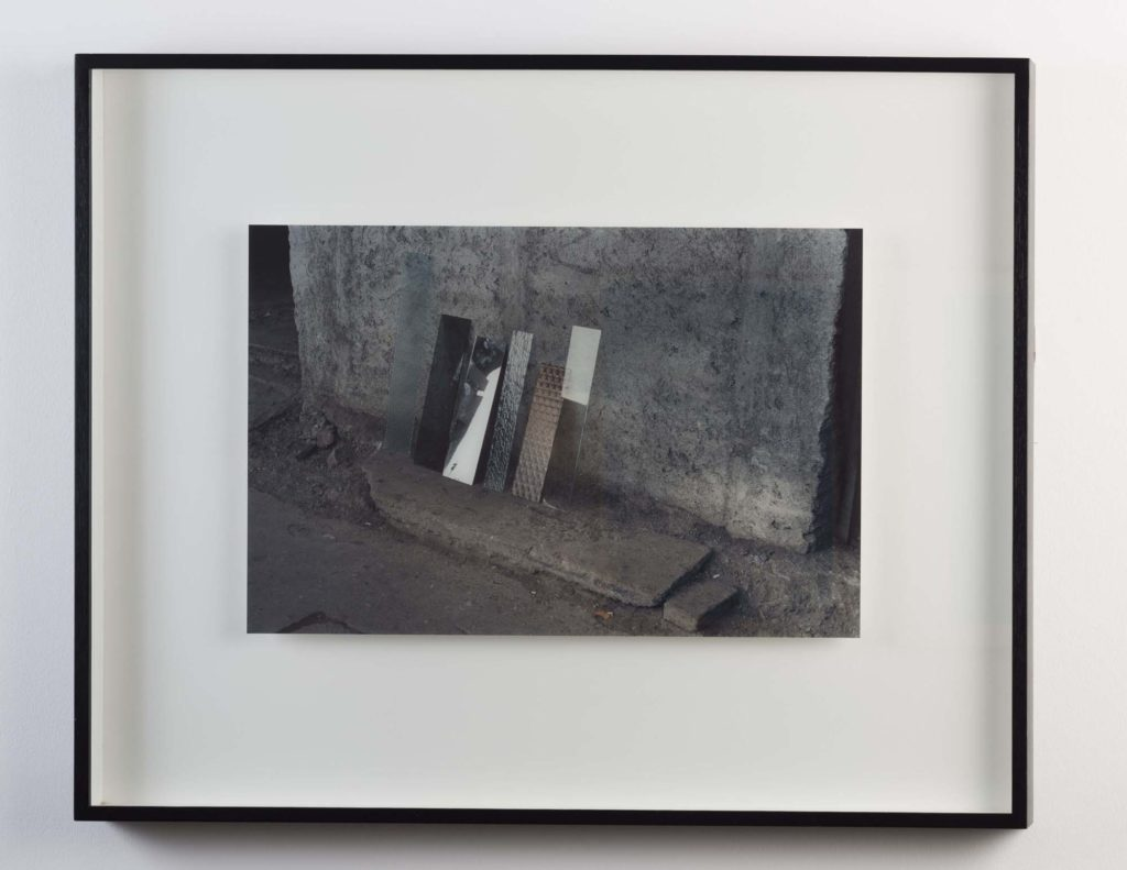 a photo of a photo of pieces of metal leaning against a wall