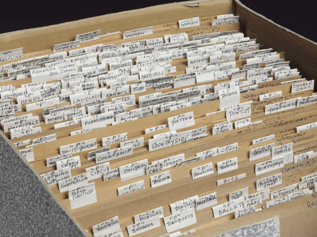 a photo of a box with files and tabs with names on them