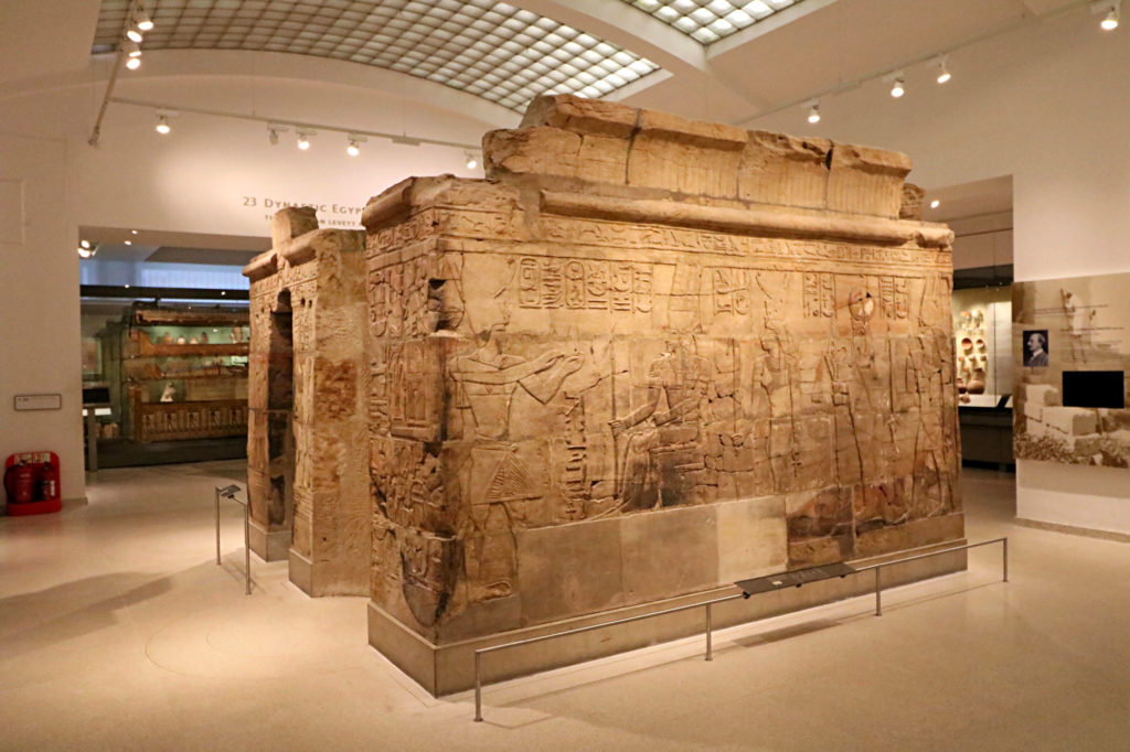 photograph of ancient egyptian building within a museum gallery