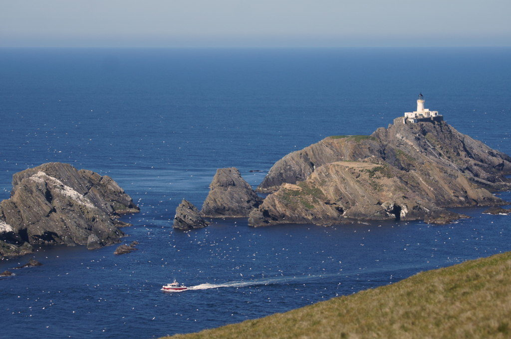 photograph of lighthouse atop a rocky island