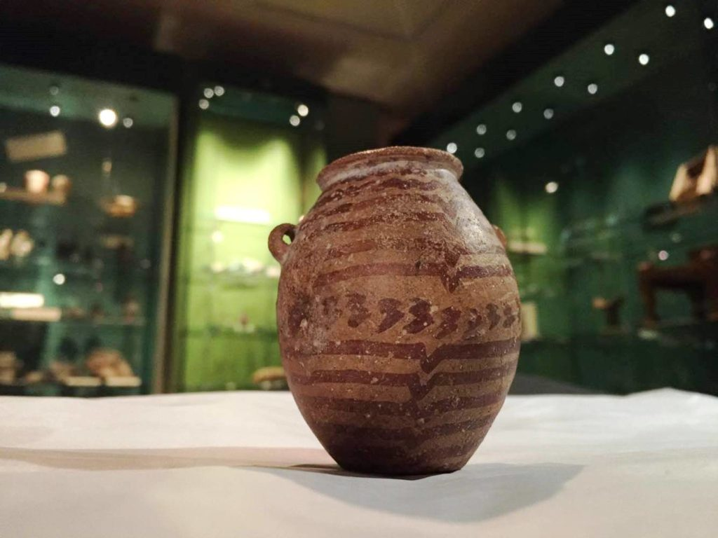 photograph of ancient pot in a museum gallery