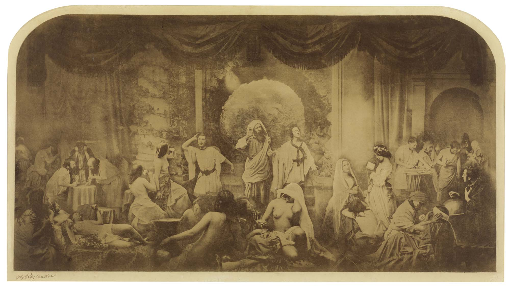 an old photograph in sepia showing an old man with a beard leading two young men into a room in whihc naked women cavort and recline whilts other clothed study and work
