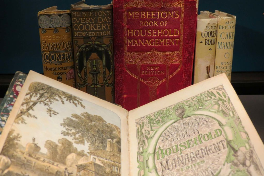 a photo of Mrs Beeton's Cookery books lined up