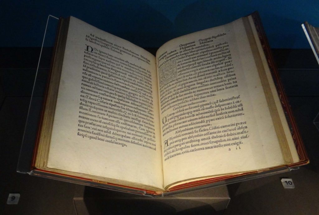 a photo of an open book with Latin text