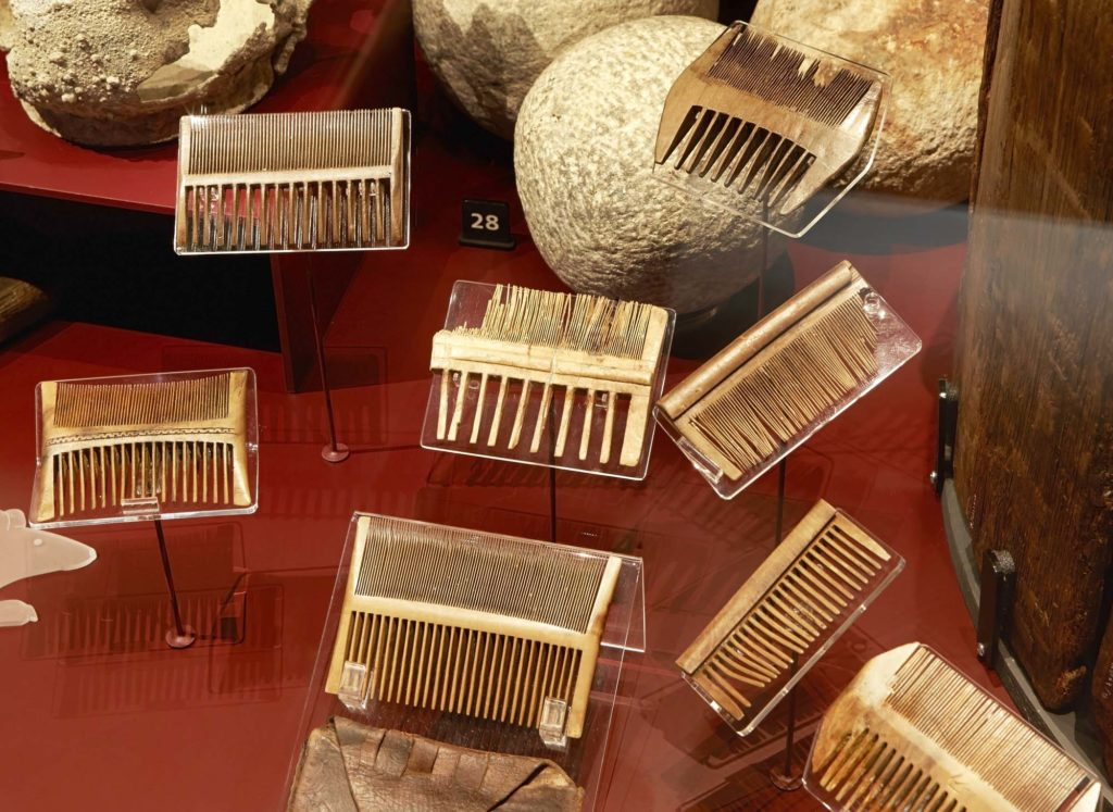 a photo of a small wooden combs in a display case