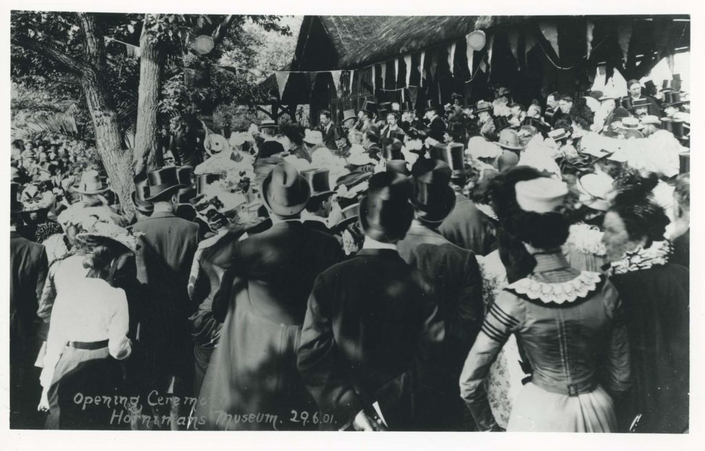 a photo of a crowd of top hatted and frock'd Edwardian men and women in a crowd