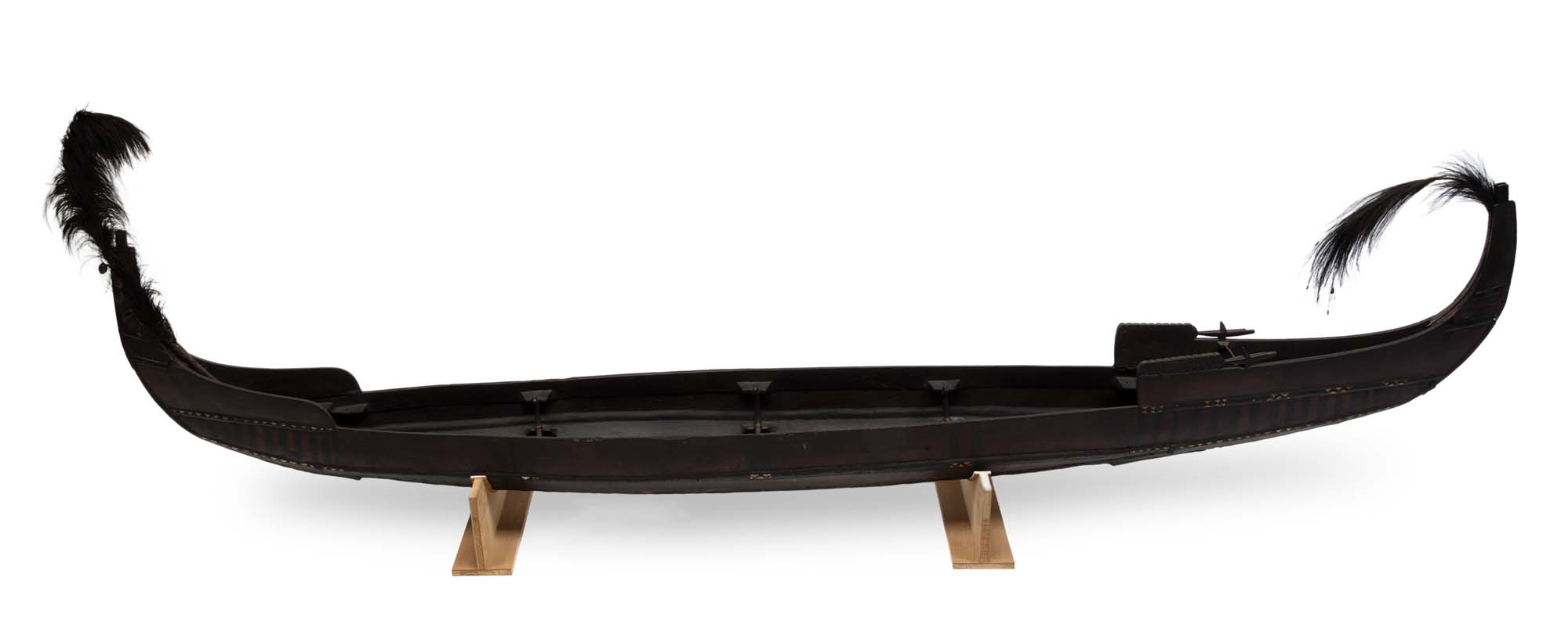 a photo of a long, slim canoe
