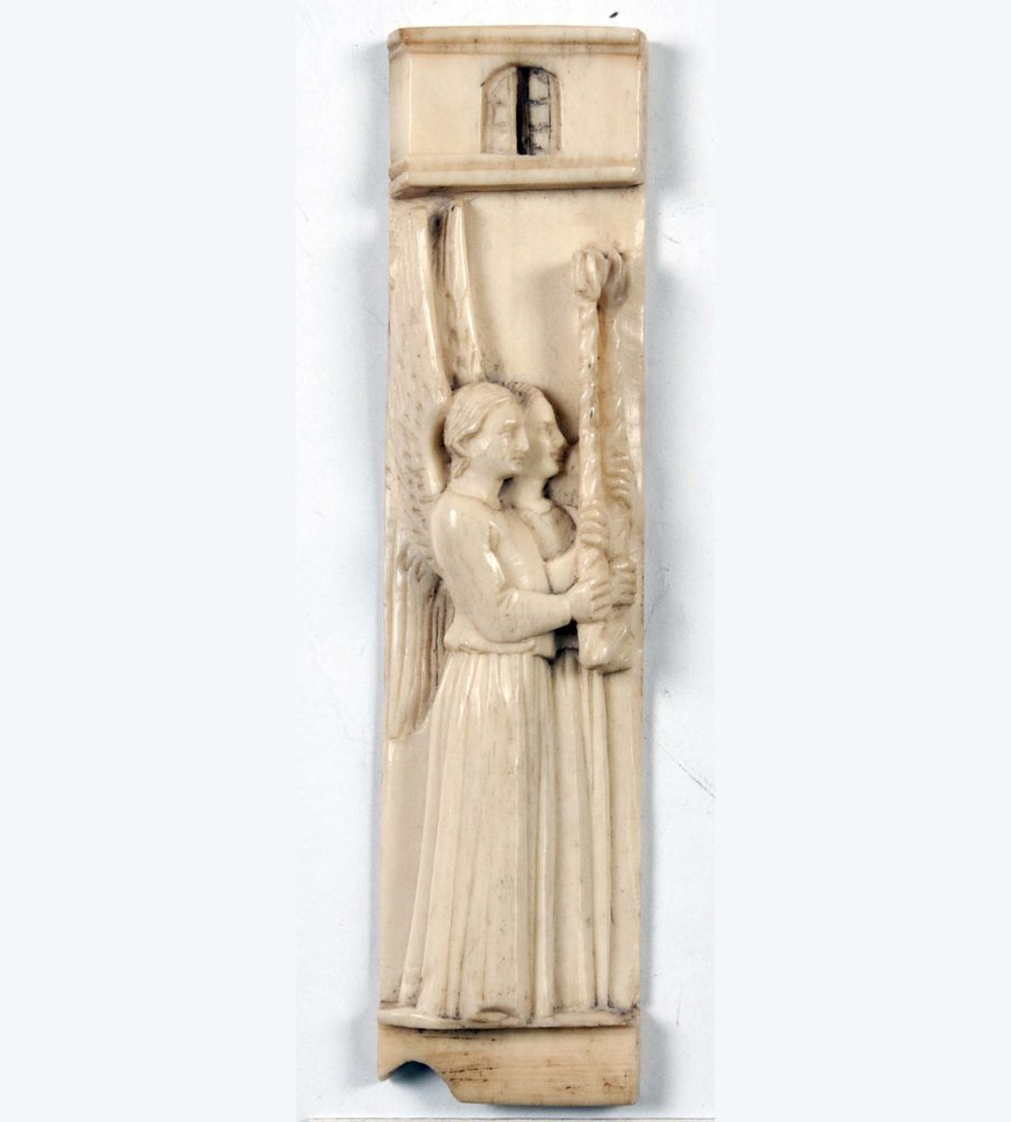 a small bone carving showing two figures carrying a torch
