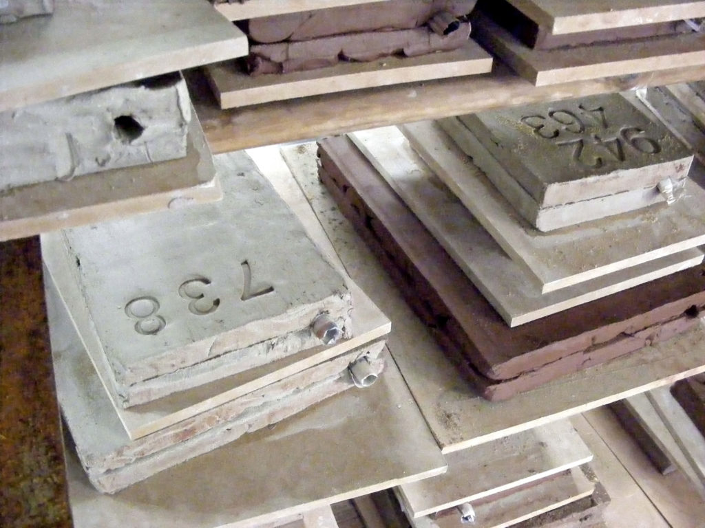 a photo of ceramic slabs with imprinted numbers on them