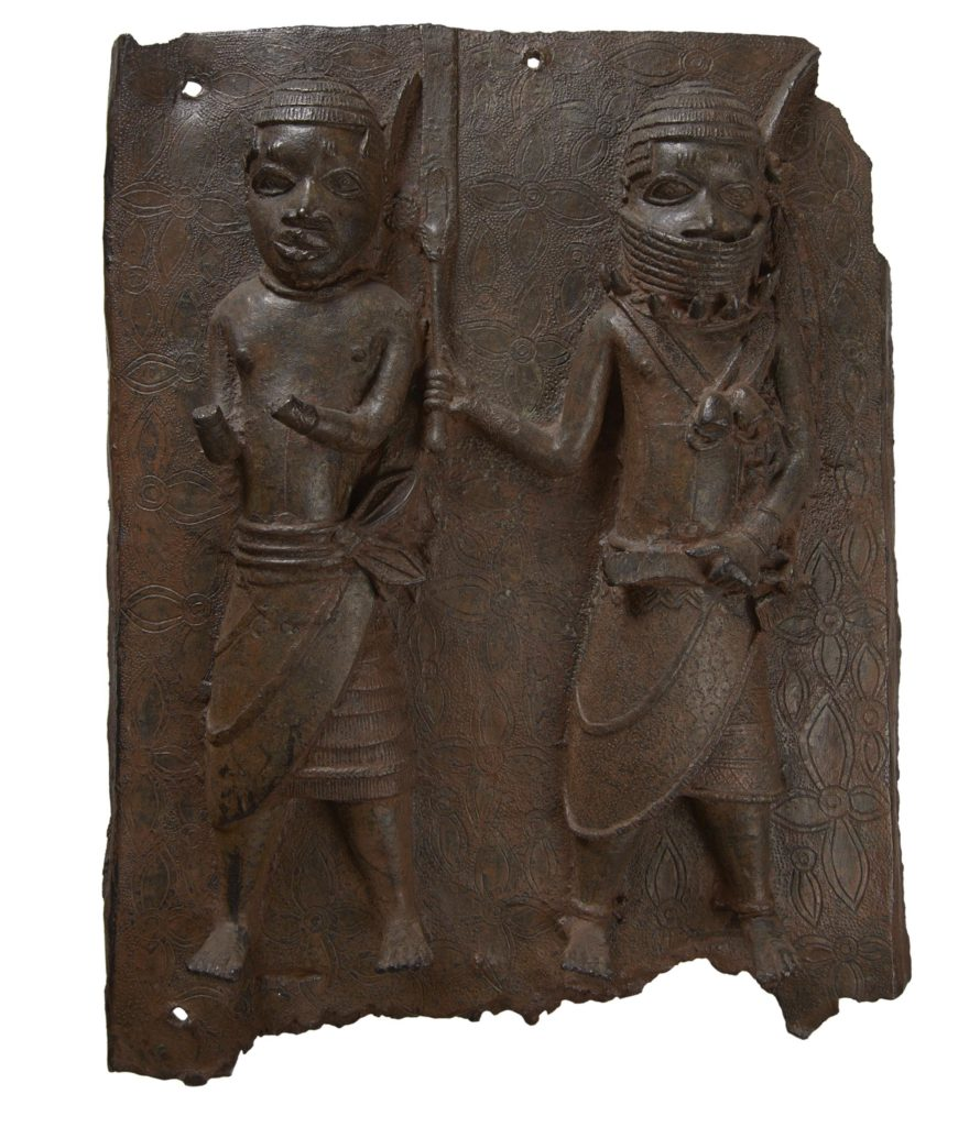 a photo of a carved plaque showing African figures