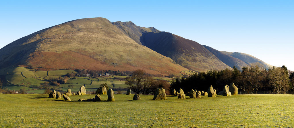 photograph of stone circle in front of mountains