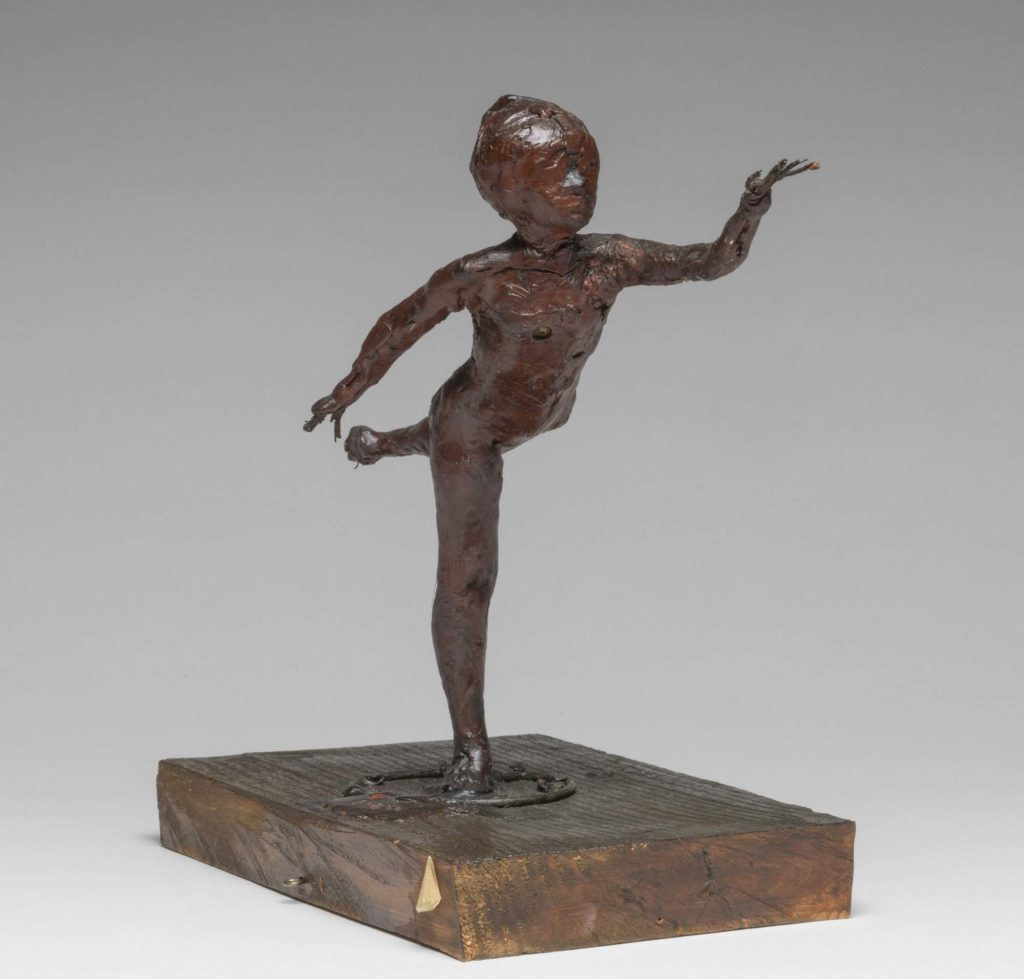 a Degas statuette in wax over wire of a young female dancer