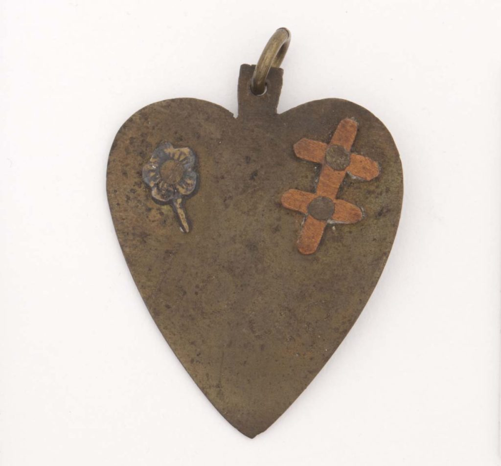 a photo of a heart shaped piece of metal