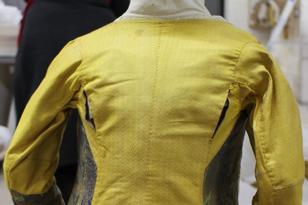a photo of a silk waistcoat with slits made into the rear seams