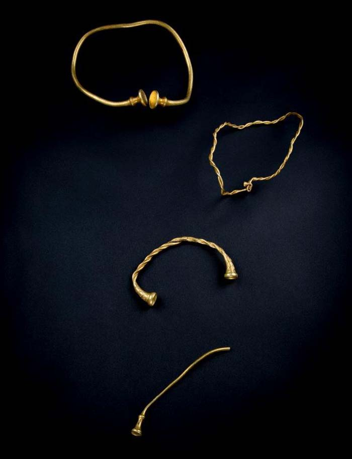 a photo of twisted golden jewellery