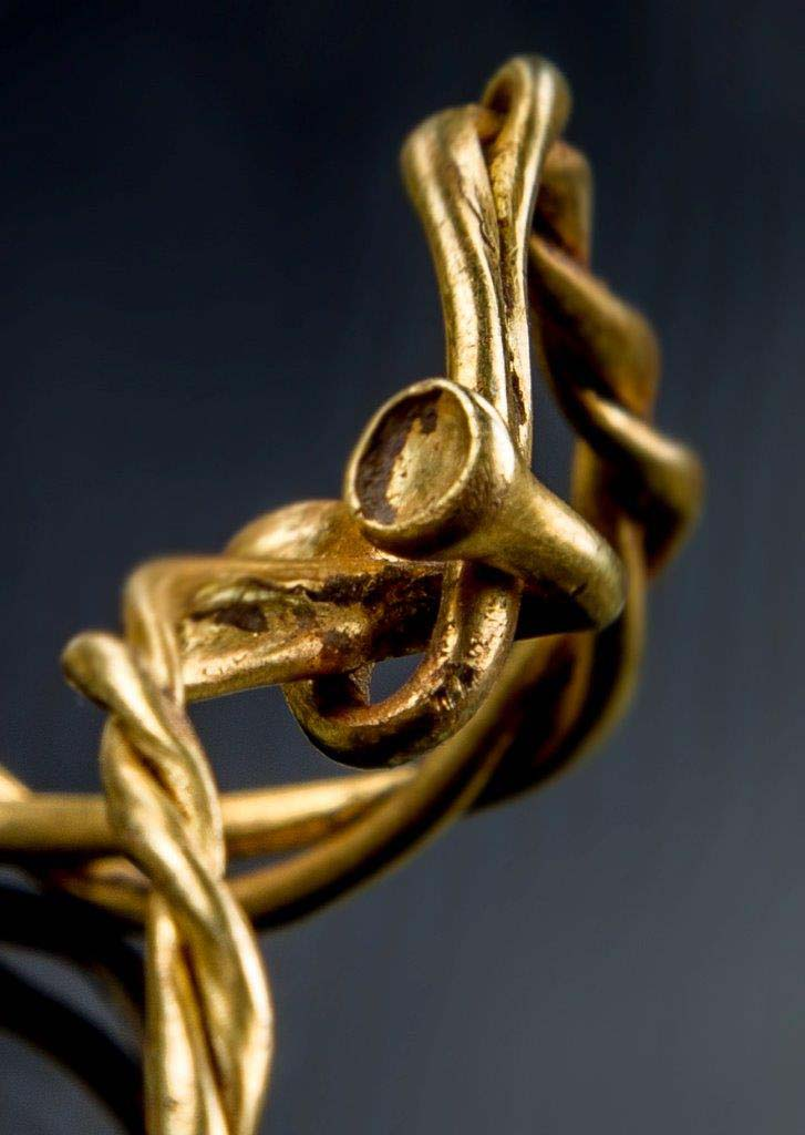 a photo of the fluted ends golden jewelry