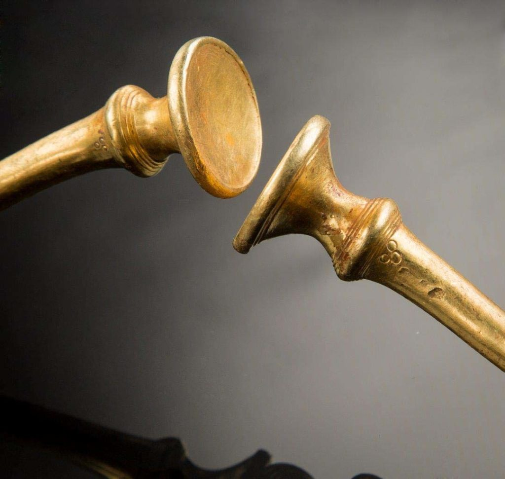 a photo of the trumpet ends golden jewelry