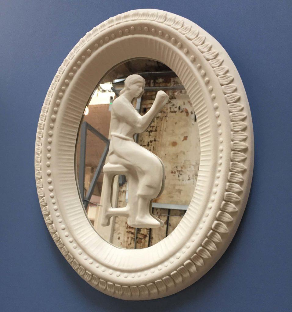 a porcelain oval mirror