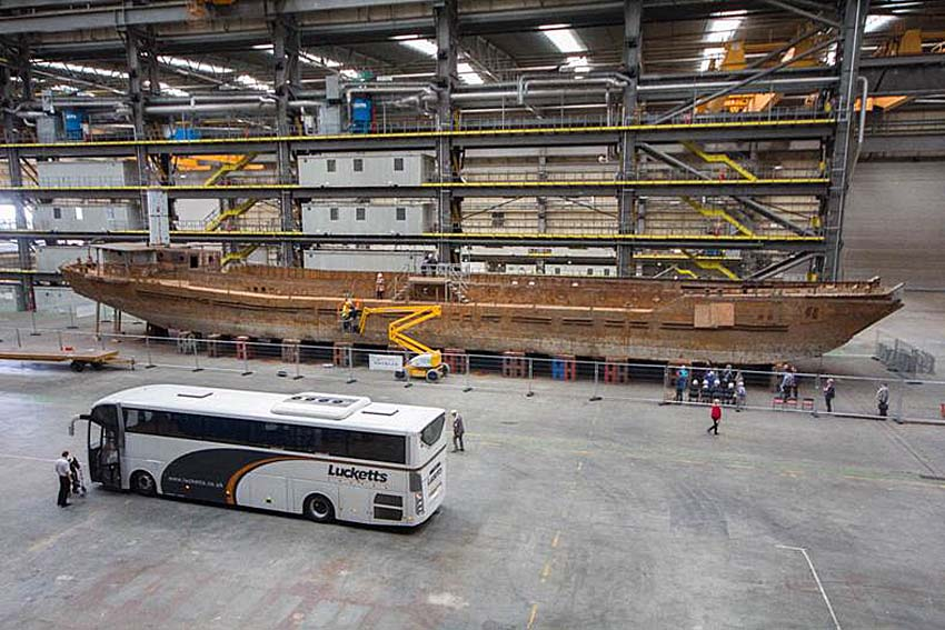 a photo of a huge vessel in a warehouse