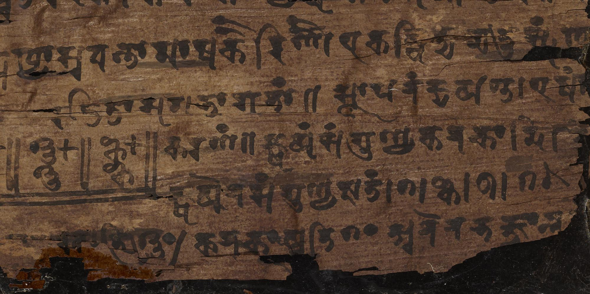 a close up of a manuscript with sanskrit wiring on nit