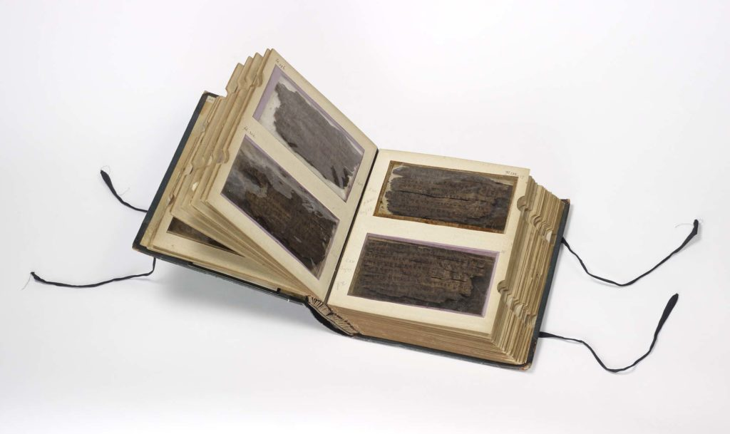a photo of an album containing manuscript findings