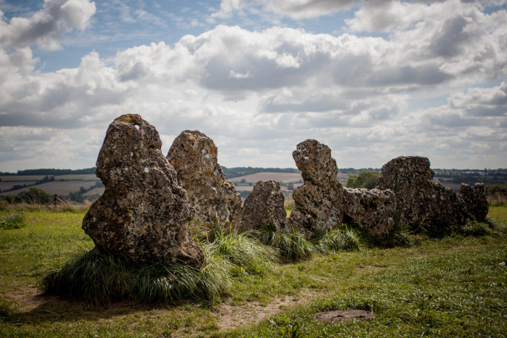 photograph of jagged standing stones atop a hill