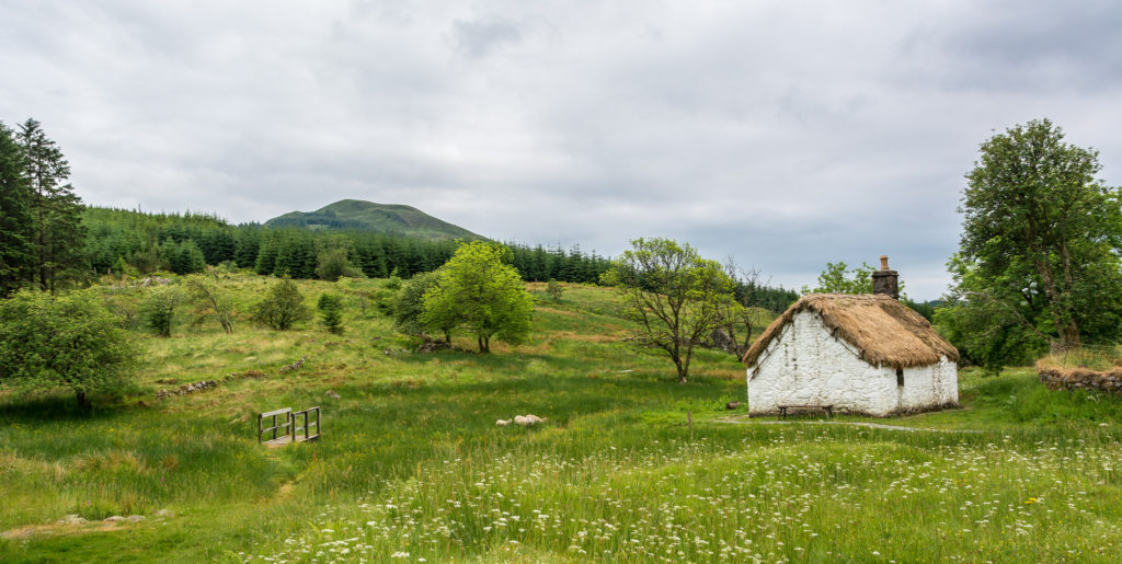 photograph of small white building in the highland countryside