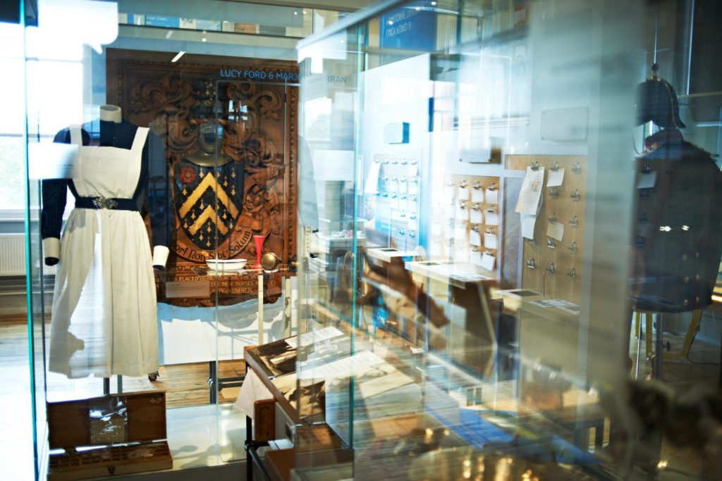photograph of interior of medical museum showing objects in display cases
