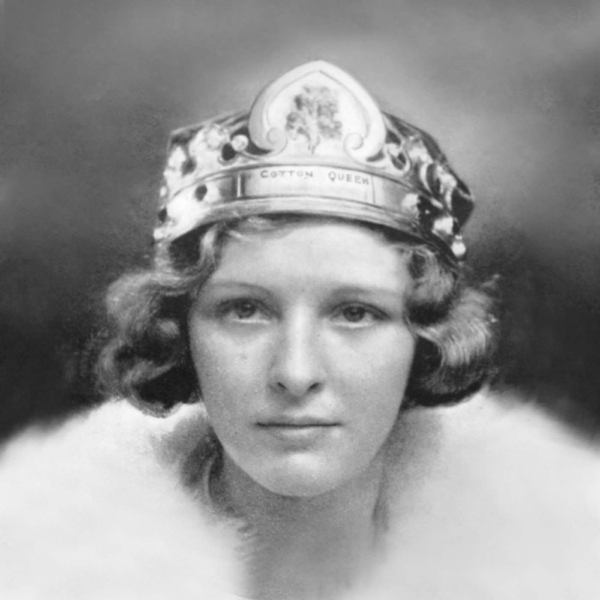a black and white portrait photo of a young woman in a tiara