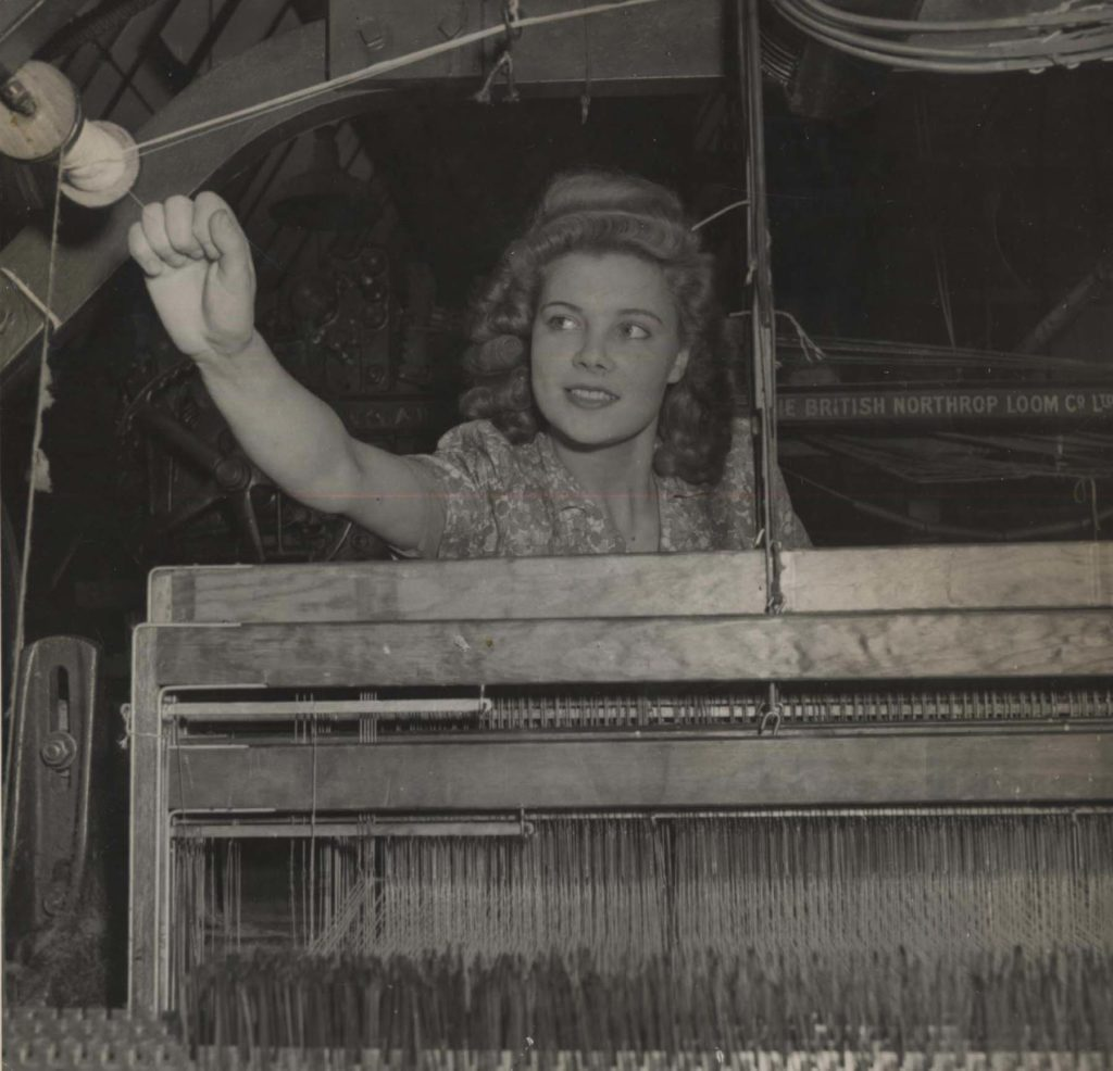 a photo of a woman on a loom