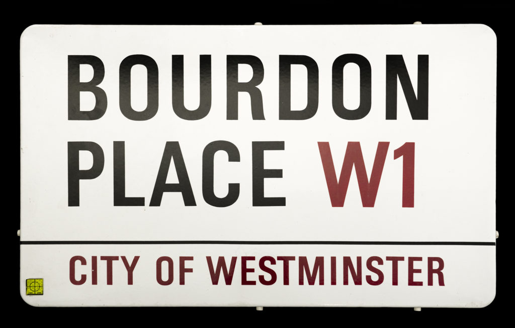 a street sign for Bourdon Place, W1, City of Westminster