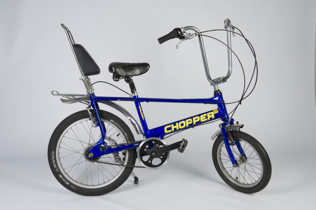 photograph of blue chopper bicycle
