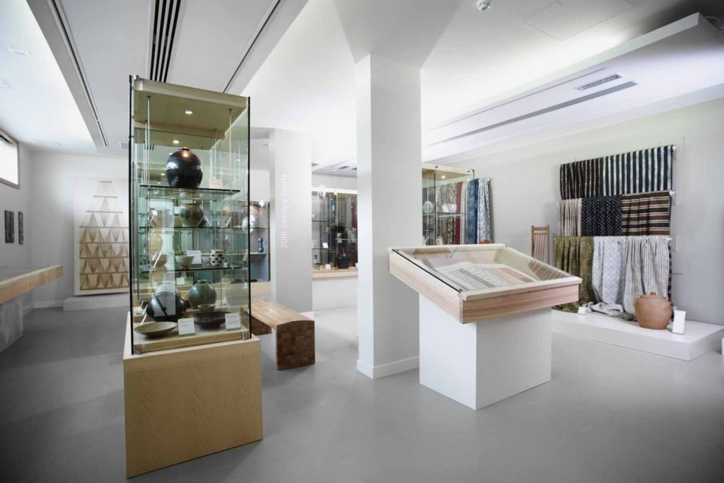 photograph of interior of gallery showing craft collection
