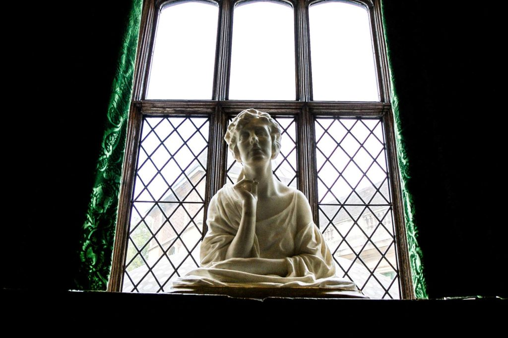 photograph of sculpture of bust of woman on windowsill