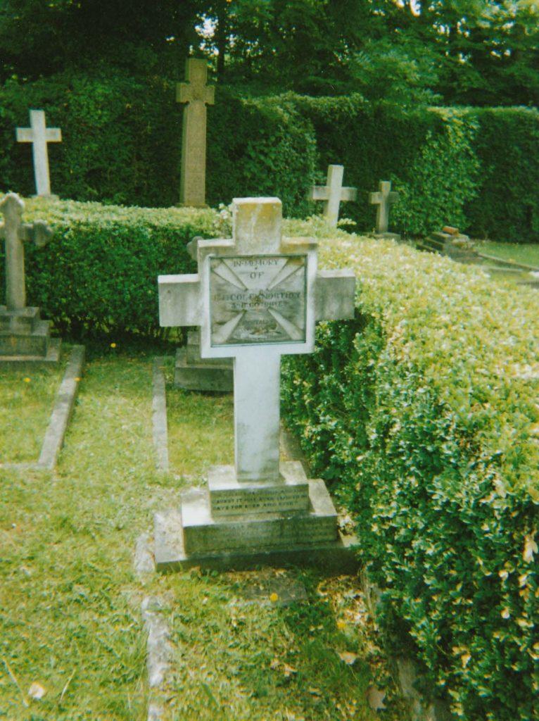 a photo of a gravestone cross