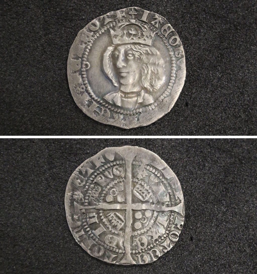 a composiet photo of two sides of a silver coin with a head of a long haired king