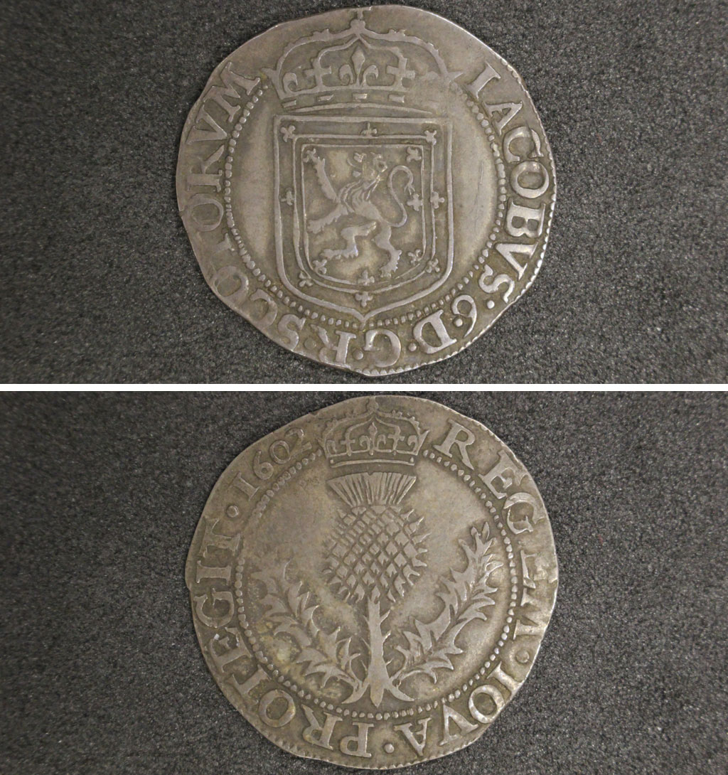 a photo of two sides of a sliver coin with thistle motif