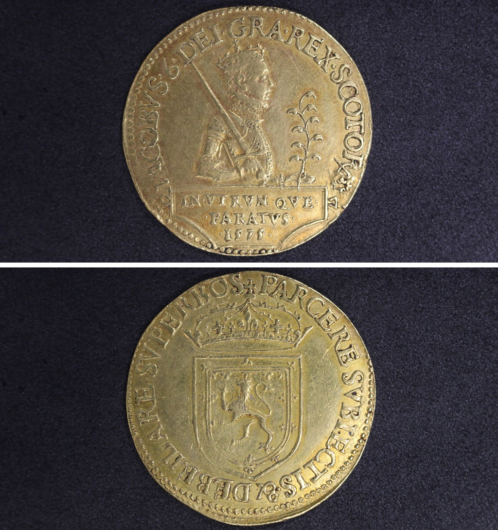 a photo of a gold coin with a king bearing a sword