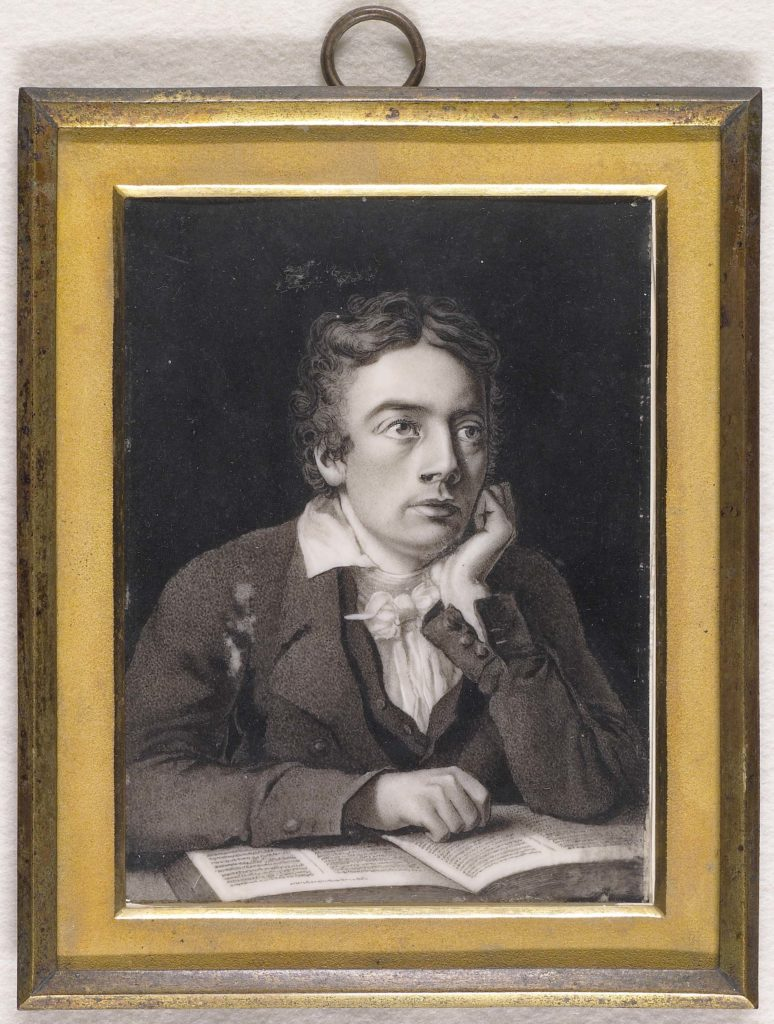 a framed print of John Keats in a frame