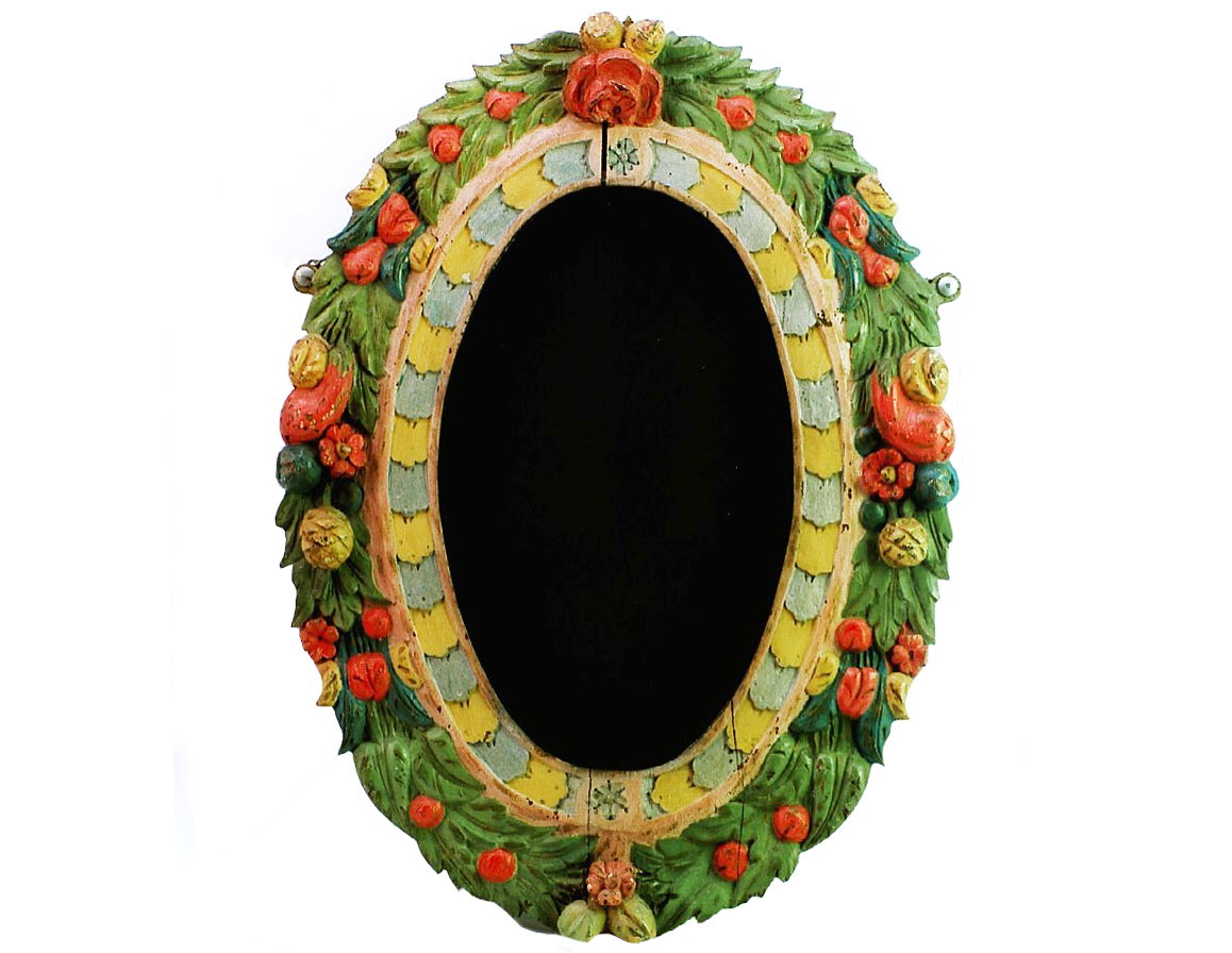 a photo of an oval mirror with dark glass and floral frame decoration