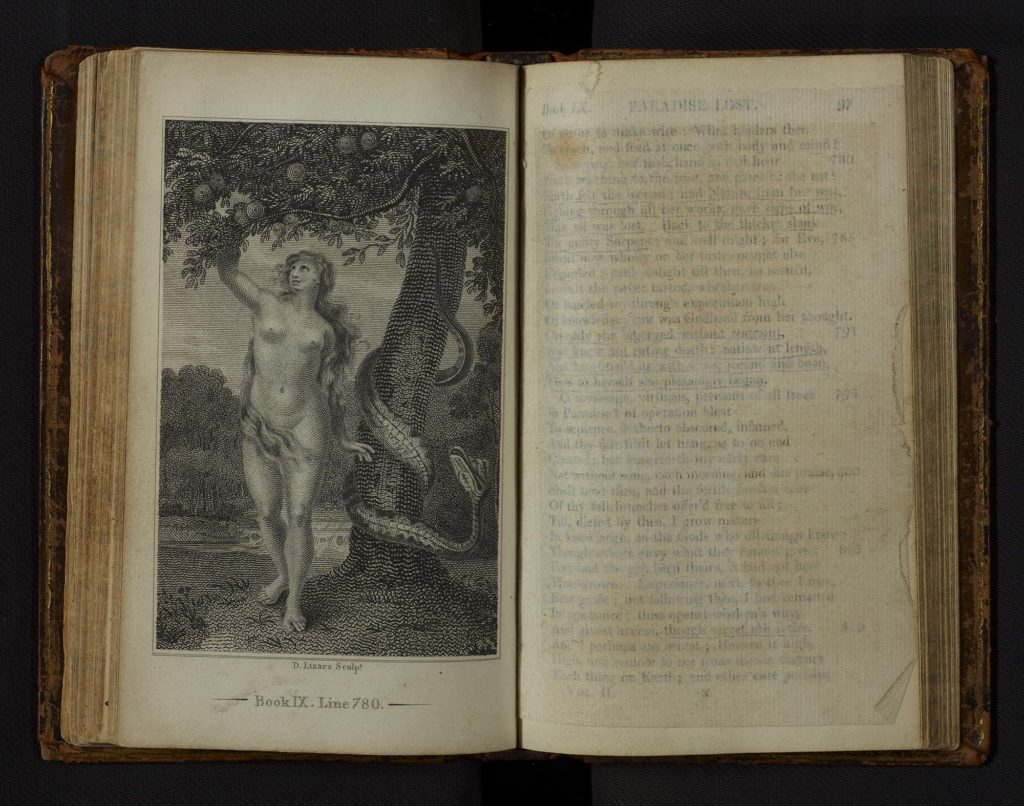 a phot of an open book with an engraving of eve on the open page