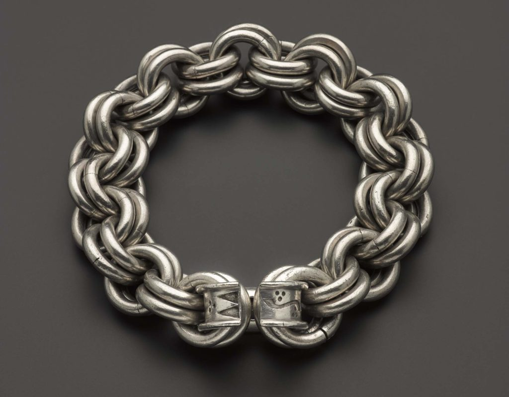 a photo of a large chunky chain made of silver rings