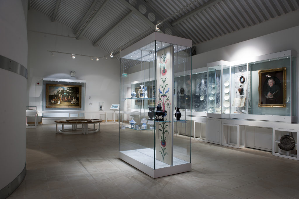 photograph of interior of museum gallery, showing ceramic pots